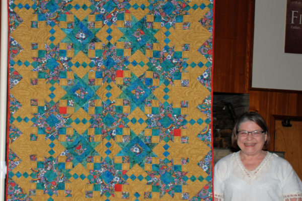 Patty Henry created & Jami Herndon quilted this as a hug for a grieving niece.