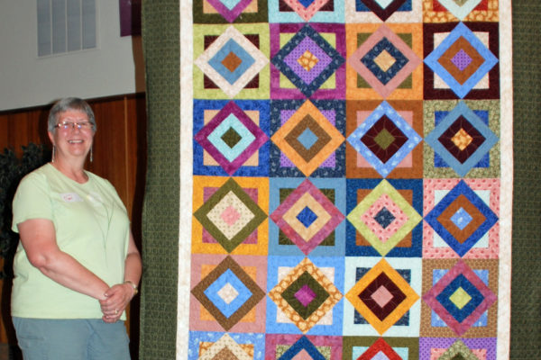 "Gail Wilson made ""Tropical Breeze"" for Cassie and Jami Herndon quilted it.  The pattern is from Cozy Quilt Designs."