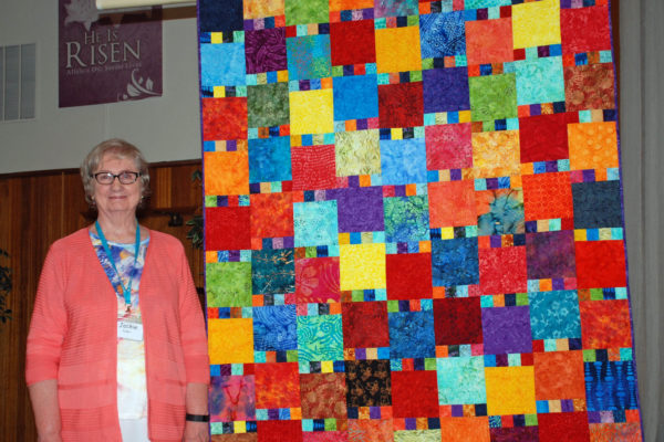 """Color Splash"" was created and quilted by Jackie Fuller from batik fabrics received in the BBQ fabric exchange years ago."