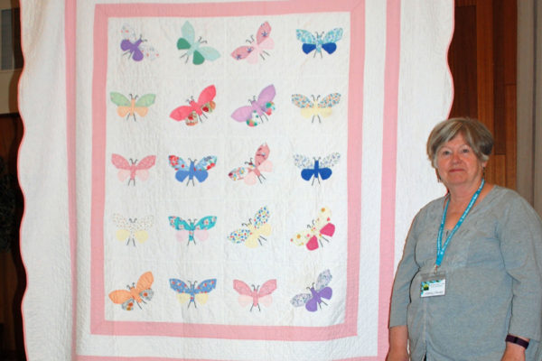 """Vintage Butterfly"" presented by Karen Falvey was a donation to the Hidden Springs Quilters. The maker & quilter are unknown."