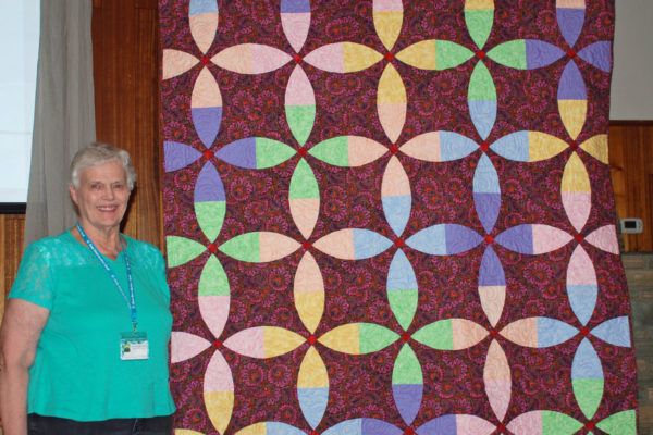 "Kenna Worthington made ""Celebrate"" from fabric exchange strips. It was quilted by Quilt Expressions."