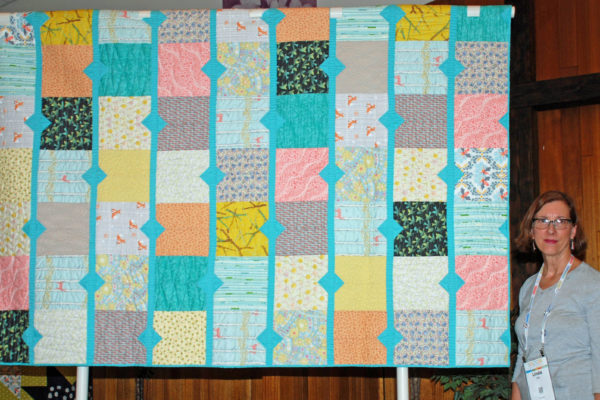 "Linda Jolly created & quilted ""in the Woods"" from the book ""Beyond Neutral""."