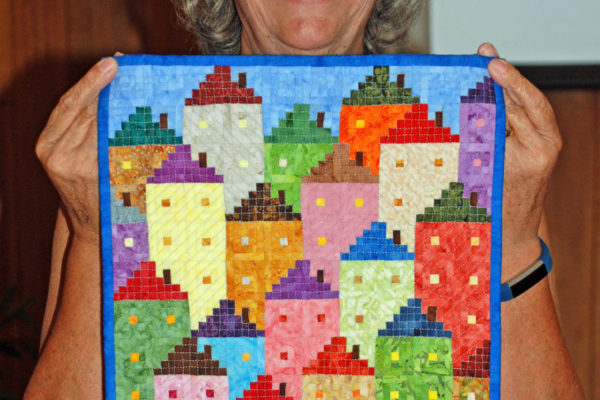 """Cabins in the Sky"" was made & quilted by Margie Braach, as she loves miniatures!  140 log cabin blocks each finish at 1 1/4 inches."
