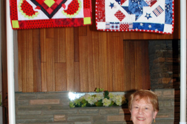 "Marie Lee took classes at Cindy''s Quilt Shop and made & quilted the one on the right as ""Fourth of July""."