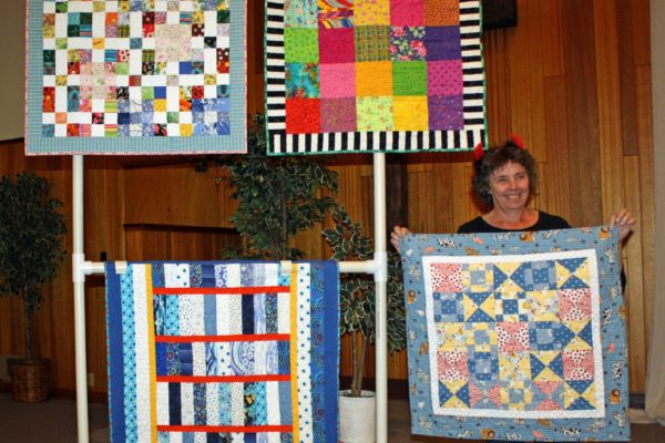 Chris Klover created & Quilted 4 scrap quilts for Neighbor kids from her stash and leftover blocks.