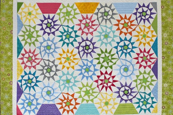 """Judge's Choice and 3rd Place - Medium Pieced by One, Quilted by Another, """"Happy Spirals"""" by Ann Swanson"""