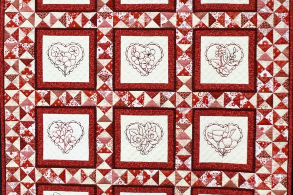 """Best Stationary Miachine Quiltinng and 2nd Place - Specialty Quilts, """"La Fleur au Coeur"""" by Madeleine Trainor"""