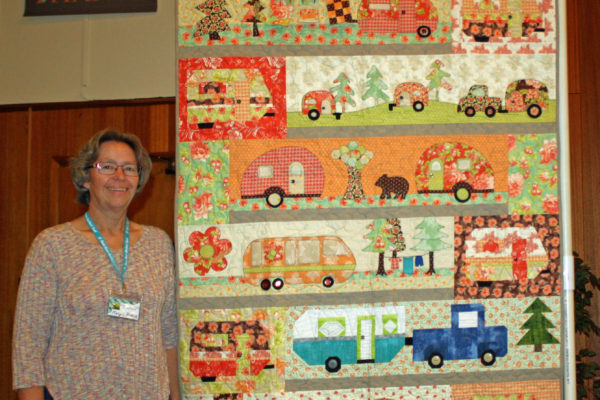 """Margie Braach created & quilted """"Rows of Campers"""" from various Shops in Idaho & Montana - Row by Row patterns."""