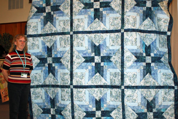 """Pat Kluckhohn created & quilted """"Bill's Quilt"""" from a Binding Tool Star Block by the Missouri Star Quilt Co.  This was hand quilted for her king size bed."""