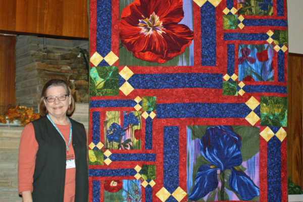 "Patty Henry gives quilts instead of flowers for funerals.  This ""hugs for Fran"" was quilted by Jami Herndon"