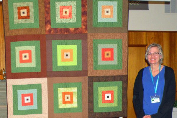 """""""Big Squares"""" was pieced by BBQ members. Danette Kroft purchased the blocks from the Silent Auction at the 2015 Quilt Show."""