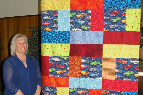 """""""Cars"""" was created & quilted by Debra Moore from a pattern 'Modified Turning Twenty' for her grandson."""
