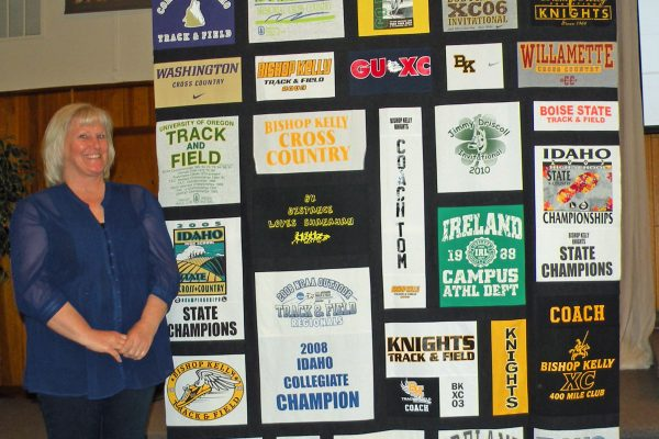 """""""T-Shirt Quilt"""" was created & quilted by Debra Moore for a co-worker."""