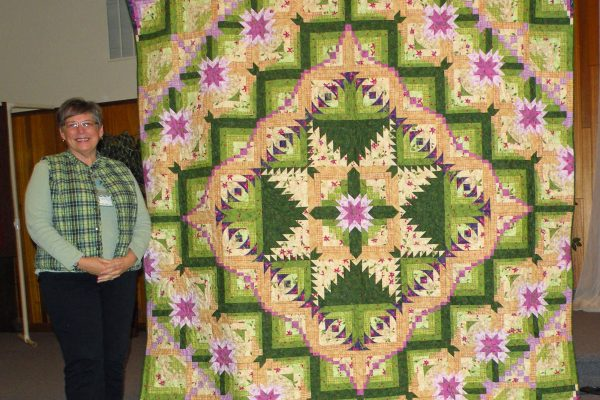 """""""Eureka"""" was created by Laura Lee & quilted by Connie Emmen. Laura does not usually use kits, but this one had just the right fabrics!"""