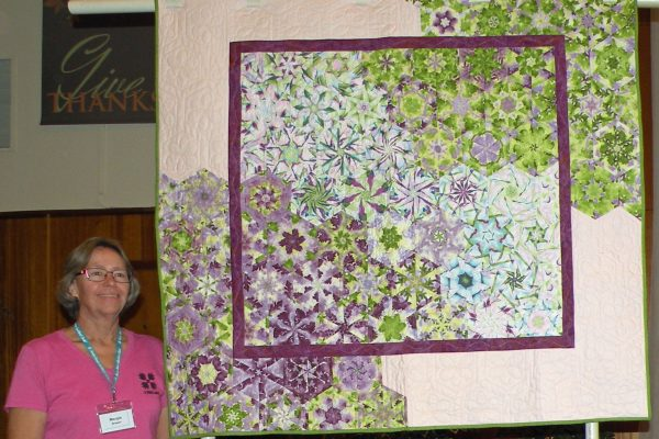 """""""One Block Wonder"""" created and quilted by Margie Braach, was started 7 years ago. A UFO she is happy to have finished!"""