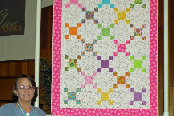 """""""Evelyn's Baby Quilt was created & quilted by Maureen Stevens, after a quilt she made for her eldest granddaughter 12 years ago.  This is for the newest granddaughter."""