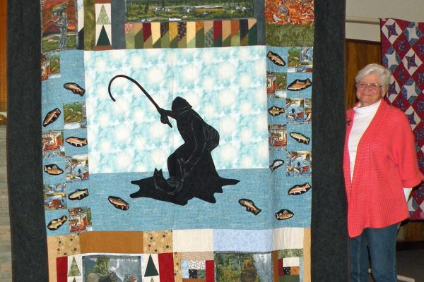 """""""Fly Fisherman"""" was created & quilted by Mitzi Aden for her husband.  This piece is hand quilted."""