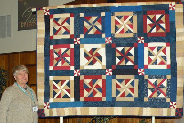 """This """"Pinwheel Quilt of Valor"""" was created & quilted by Nancy England, just because she like the pattern and saw it as a Quilt of Valor!"""