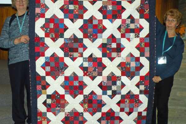 """""""Retro Crossroads"""" was presented by the small group Piece in the Valley.  The three quilts were made from scraps as charity quilts and quilted by Jami Herndon, Connie Emmen and Linda Jolly."""