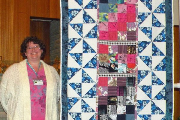 """""""Sue's Memorial"""" was created & quilted by Shannon Wilson. These were designed from a friend's shirts as the center focus blocks."""