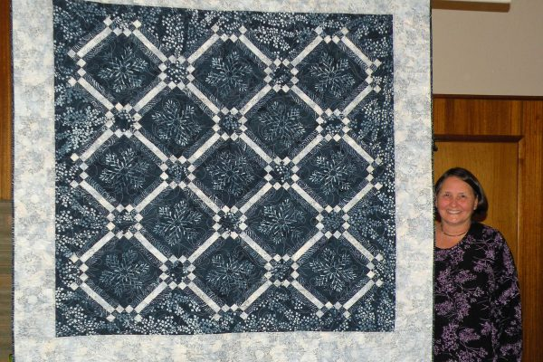 "Bev Sheeley created & Linda Jolly quilted ""Winter 2016-17"" for the pattern 'Let it Snow Again' by Laundry Basket Quilts."