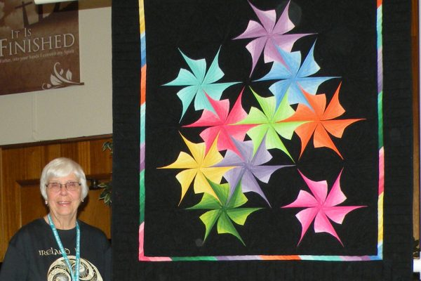 """Spinners"" made by Donna Mumford & quilted by Connie Emmen."
