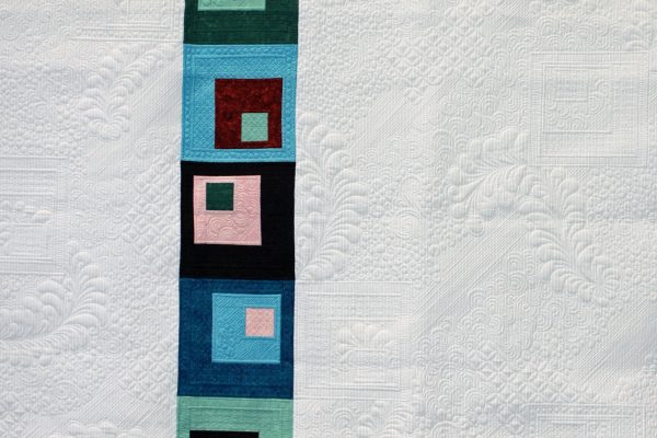 "1st Place - ""My 1st Negative Space"" created & quilted by Nancy Stricklin on a track mounted machine."