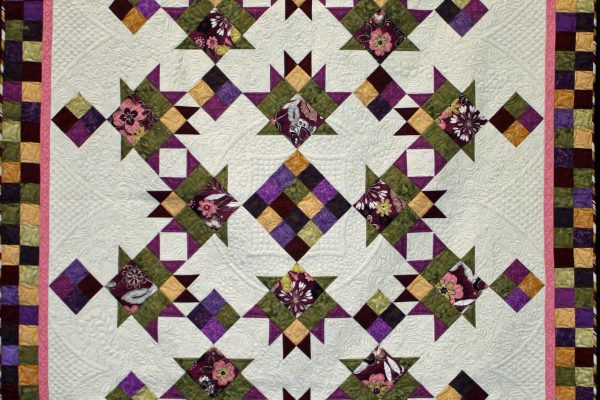 "1st Place - ""Very Berry Baskets"" by Carol Herbst; quilted by Vickie Guthrie on a track mounted machine."