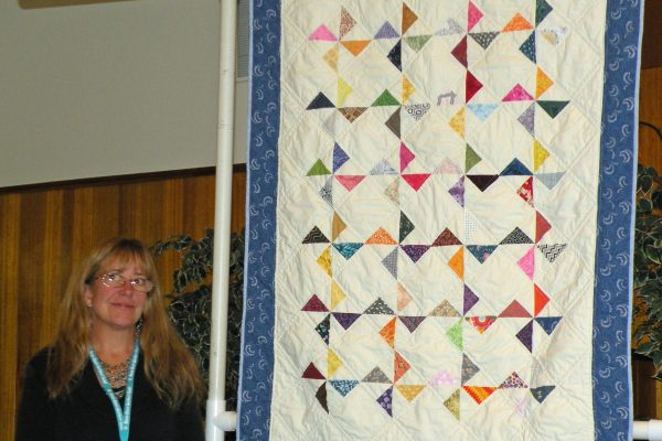 """Spin Wheels"" created & quilted by Sharon Culley. Pattern is from Better Homes & Gardens."