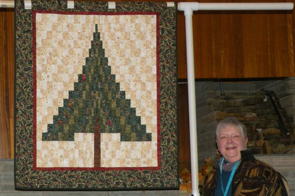 "Phyllis Kizer made this ""Bargello Christmas"", quilted by Laurel Bennett."
