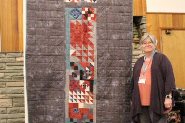 Karen Falvey wanted to use up leftover blocks and fabric from a Downton Abbey Quilt.  She started out with a table runner and ended up with a twin size bed quilt that will coordinate with a queen size quilt in their AirBnB.